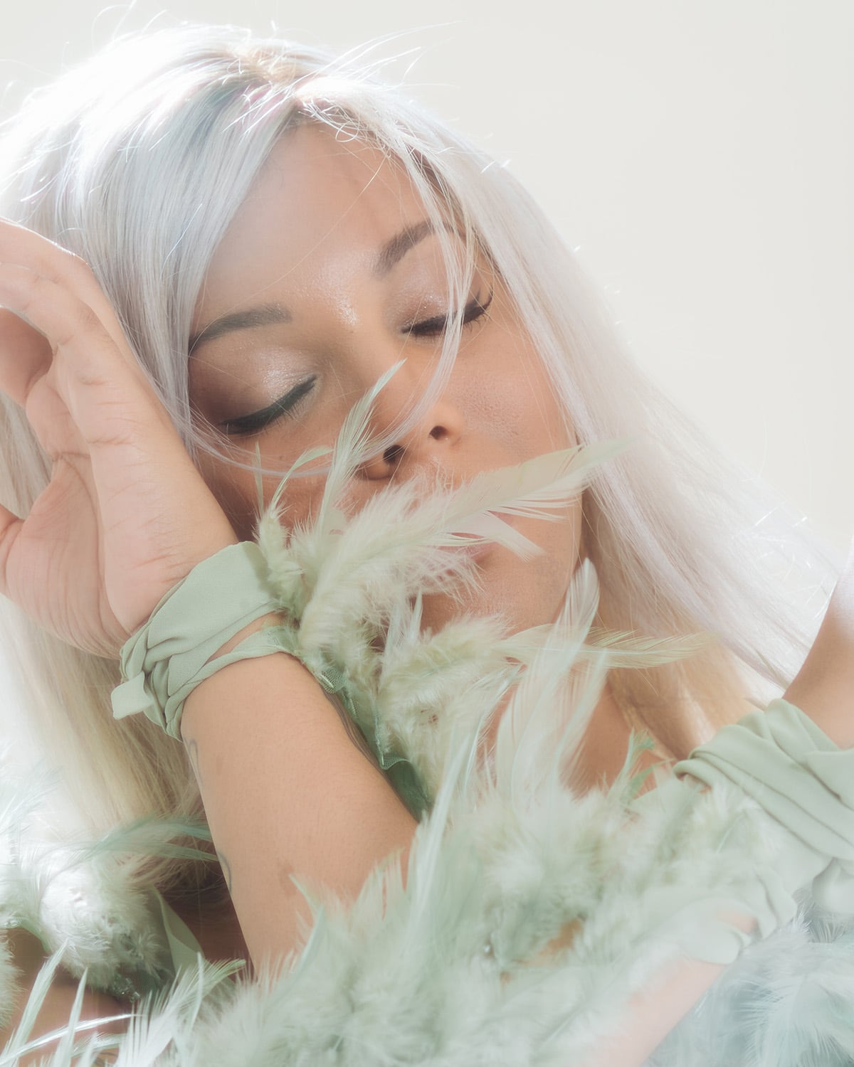Soft vintage portrait photography of trans activist Munroe Bergdorf by London portrait photographer Ira Giorgetti