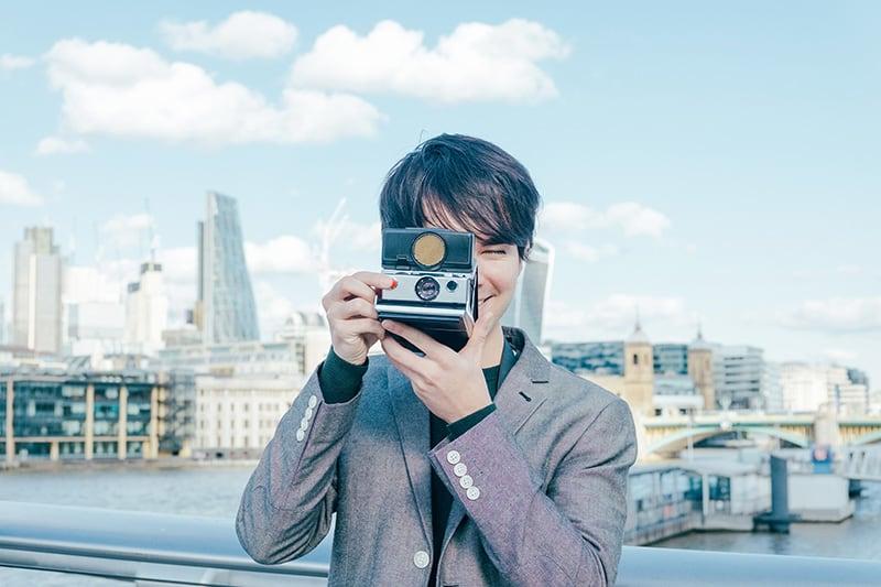 Portrait of London fashion photographer Ira Giorgetti captured on the Millennium Bridge