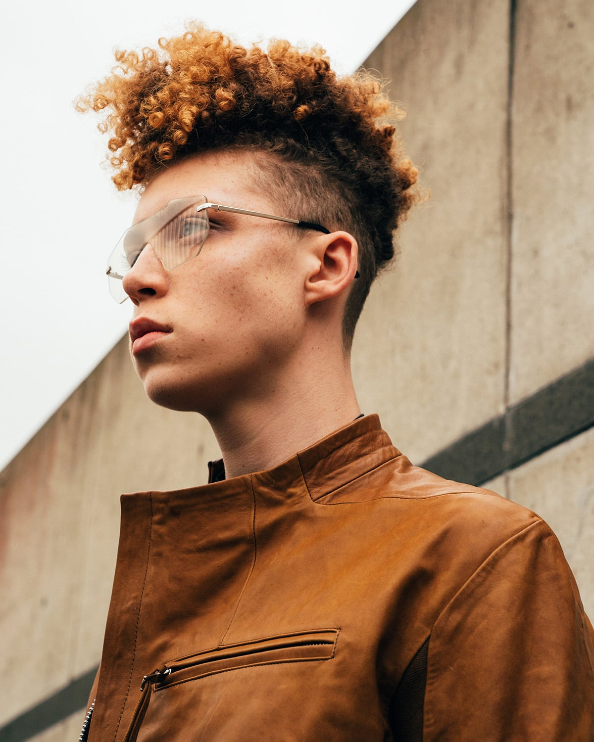 Menswear fashion photography by London editorial photographer Ira Giorgetti featuring male model Luis shot on location in Thames Barrier Park